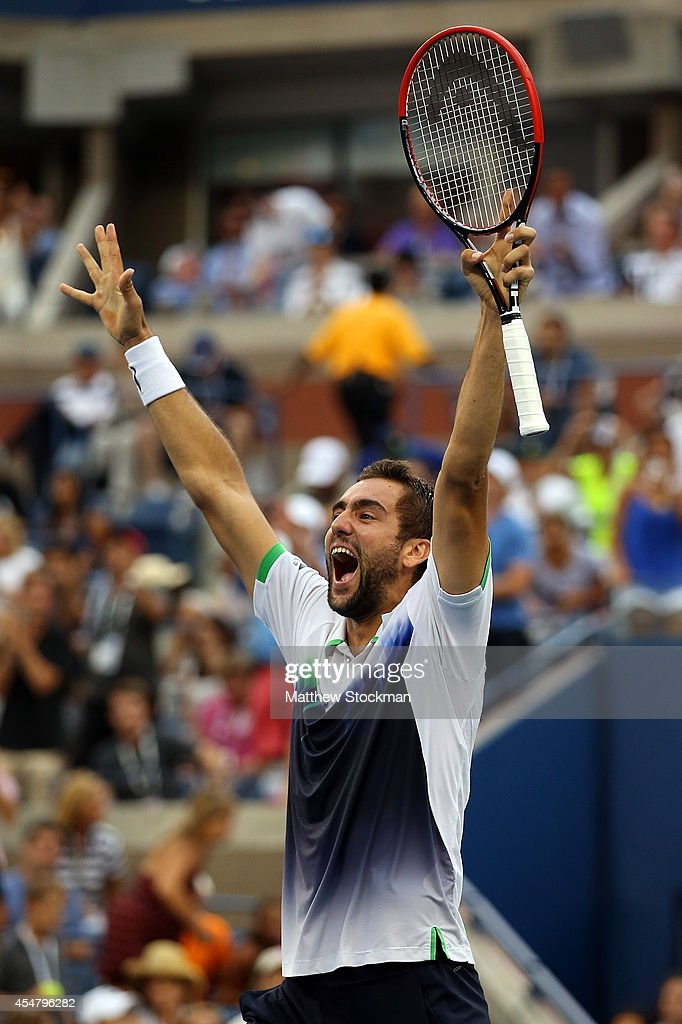 Marin Cilic of Croatia celebrates after defeating Roger Federer of Switzerland during their men's singles semifinal match on Day Thirteen of the 2014 US Open at the USTA Billie Jean King National Tennis Center on September 6, 2014 in the Flushing neighborhood of the Queens borough of New York City. Cilic defeated Federer in three sets 6-3, 6-4, 6-4.