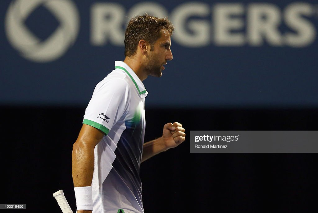 Marin Cilic of Croatia celebrates after winning the second set against Roger Federer of Switzerland during Rogers Cup at Rexall Centre at York University on August 7, 2014 in Toronto, Canada.