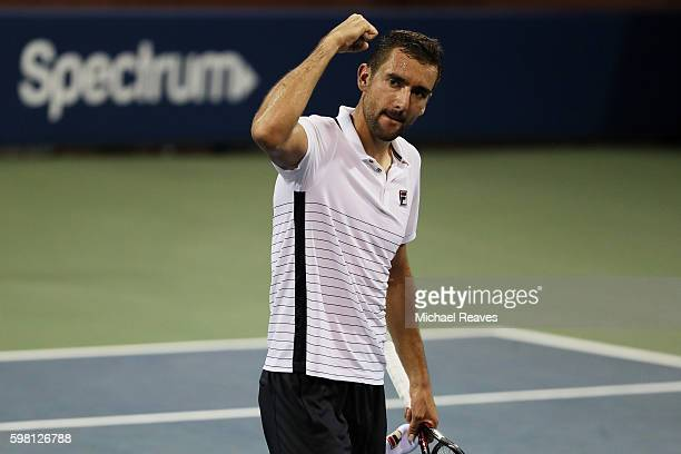 Marin Cilic of Croatia celebrates his victory over Sergiy Stakhovsky of Ukraine during his second round Men's Singles match on Day Three of the 2016...