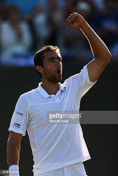 Marin Cilic of Croatia celebrates victory in his Gentlemen's Singles Fourth Round match against Denis Kudla of the United States during day seven of...