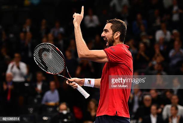 Marin Cilic of Croatia celebrates victory over Novak Djokovic of Serbia during the Mens Singles quarter final match on day five of the BNP Paribas...