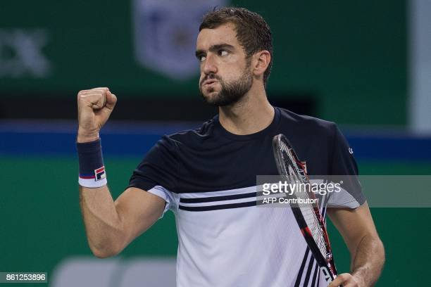 Marin Cilic of Croatia celebrates winning a point during his men's semifinals singles match against Rafael Nadal of Spain at the Shanghai Masters...