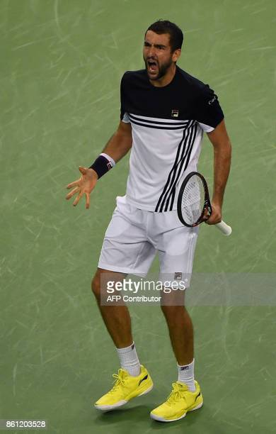 Marin Cilic of Croatia gestures against Rafael Nadal of Spain during their men's singles semifinal match at the Shanghai Masters tennis tournament in...