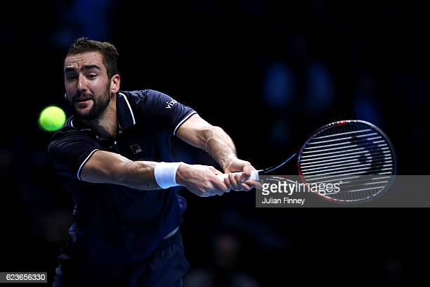 Marin Cilic of Croatia hits a backhand during his men's singles match against Stan Wawrinka of Switzerland on day four of the ATP World Tour Finals...