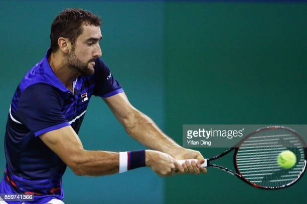 Marin Cilic of Croatia hits a backhand during the Men's singles match against Kyle Edmund of Great Britain on day three of the Shanghai Rolex Masters...