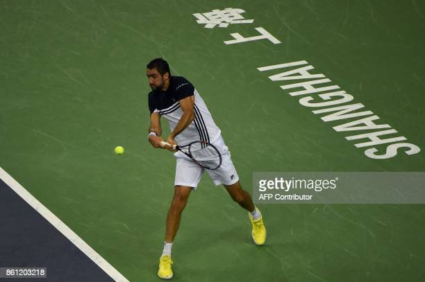 Marin Cilic of Croatia hits a return against Rafael Nadal of Spain during their men's singles semifinal match at the Shanghai Masters tennis...