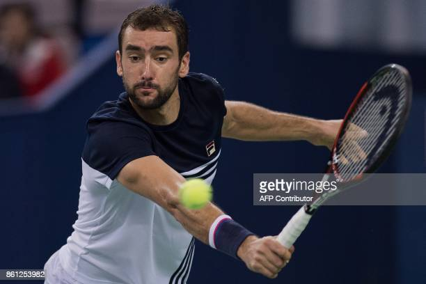 Marin Cilic of Croatia hits a return during his men's semifinals singles match against Rafael Nadal of Spain at the Shanghai Masters tennis...
