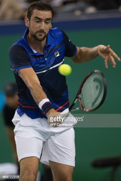 Marin Cilic of Croatia hits a return during the men's singles against Kyle Edmund of Britain at the Shanghai Masters tennis tournament in Shanghai on...