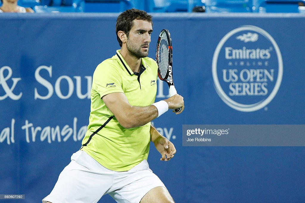 Marin Cilic of Croatia hits a return to Grigor Dimitrov of Bulgaria during a semifinal match on Day 8 of the Western & Southern Open at the Lindner Family Tennis Center on August 20, 2016 in Mason, Ohio.