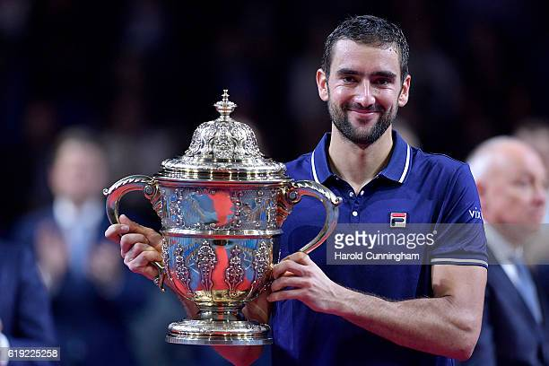 Marin Cilic of Croatia holds the trophy as he celebrates his victory during the Swiss Indoors ATP 500 tennis tournament final match against Kei...