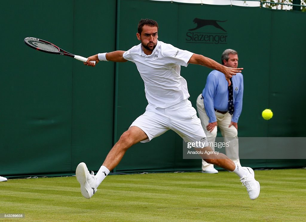Marin Cilic of Croatia in action against Brian Baker of USA in the mens' singles on day one of the 2016 Wimbledon Championships at the All England Lawn Tennis and Croquet Club in London, United Kingdom on June 27, 2016.