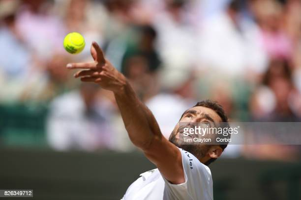 Marin Cilic of Croatia in action against Gilles Muller of Luxembourg in the Mens' Singles Quarter Final match on Court One during the Wimbledon Lawn...
