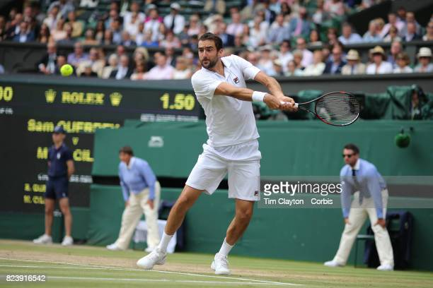 Marin Cilic of Croatia in action against Sam Querrey of the United States in the Gentlemen's Singles Semifinal of the Wimbledon Lawn Tennis...