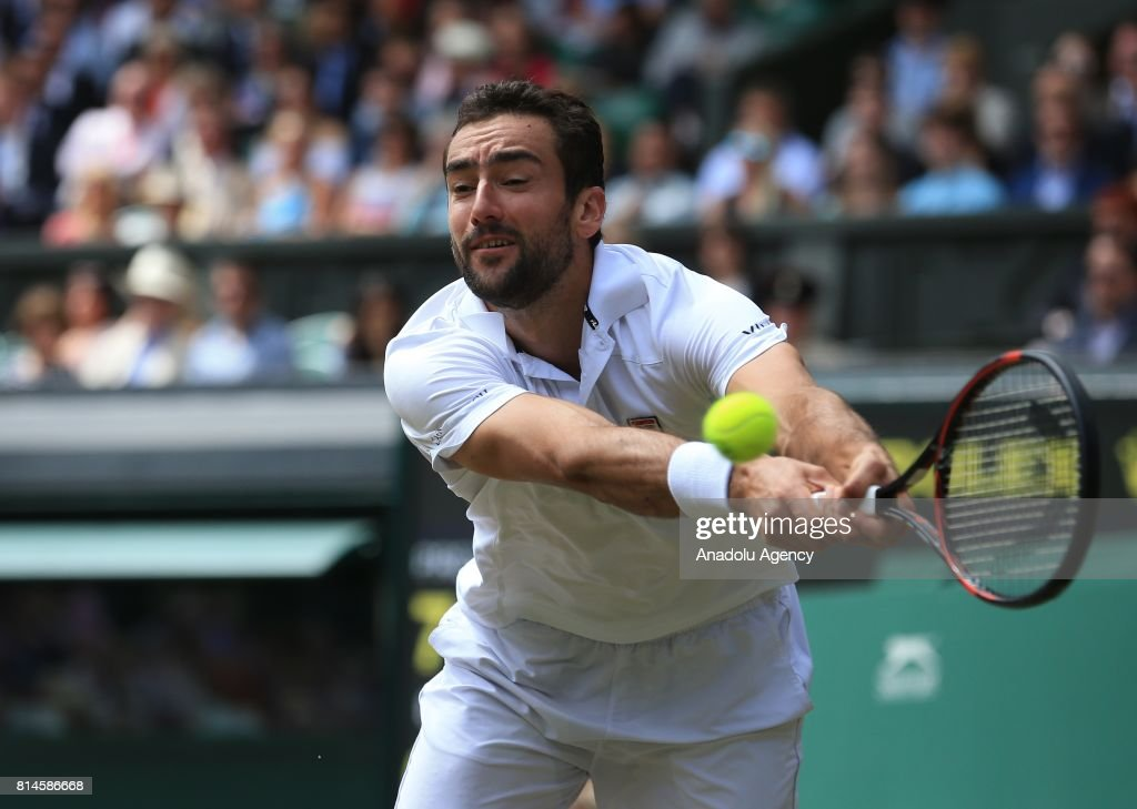 Marin Cilic of Croatia in action against Sam Querrey of USA (not seen) in the men's semi-finals on day eleven of the 2017 Wimbledon Championships at the All England Lawn and Croquet Club in London, United Kingdom on July 14, 2017.