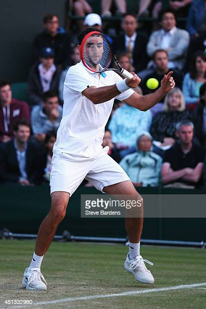Marin Cilic of Croatia in action during his Gentlemen's Singles third round match against Tomas Berdych of Czech Republic on day five of the...