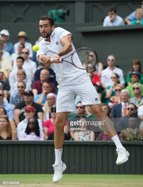 Marin Cilic of Croatia in action during the Men's Singles Final against Roger Federer of Switzerland on day thirteen of the Wimbledon Lawn Tennis...
