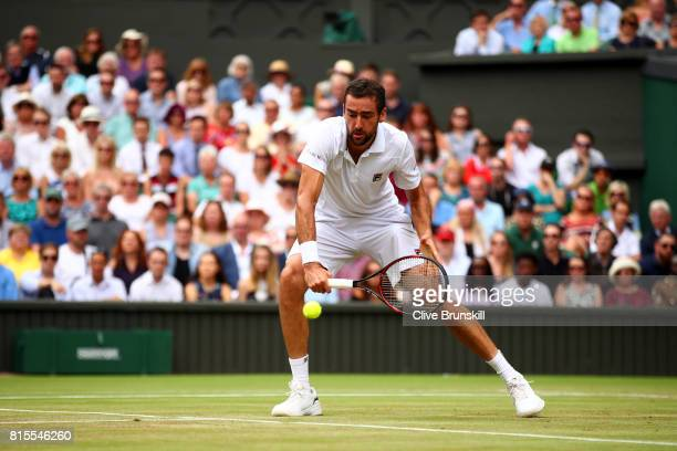 Marin Cilic of Croatia plays a backhand during the Gentlemen's Singles final against Roger Federer of Switzerland on day thirteen of the Wimbledon...