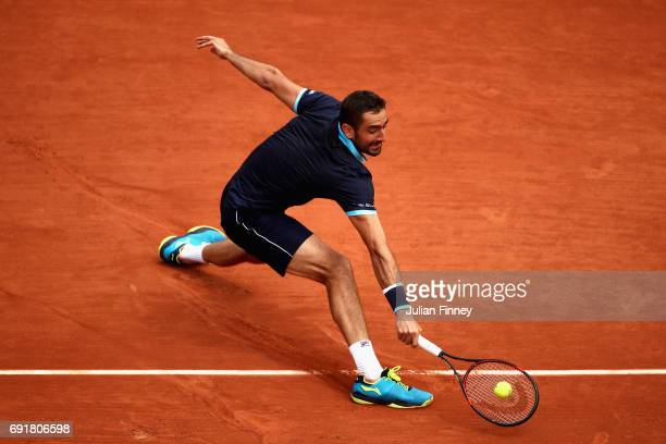 Marin Cilic of Croatia plays a backhand during the mens singles third round match against Feliciano Lopez of Spain on day seven of the 2017 French...