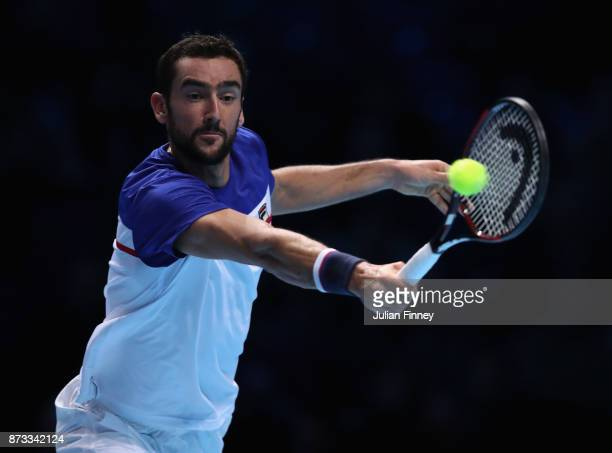 Marin Cilic of Croatia plays a backhand in his match against Alexander Zverev of Germany during day one of the Nitto ATP World Tour Finals tennis at...