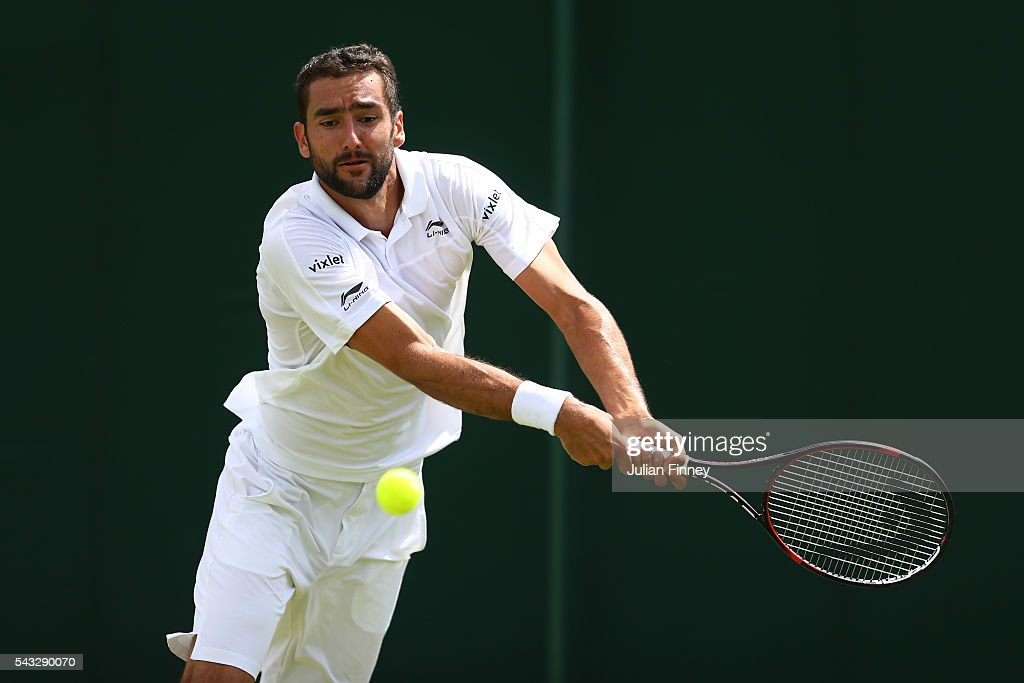<a gi-track='captionPersonalityLinkClicked' href=/galleries/search?phrase=Marin+Cilic&family=editorial&specificpeople=553788 ng-click='$event.stopPropagation()'>Marin Cilic</a> of Croatia plays a backhand shot during the Men's Singles first round against Brian Baker of The United States on day one of the Wimbledon Lawn Tennis Championships at the All England Lawn Tennis and Croquet Club on June 27th, 2016 in London, England.