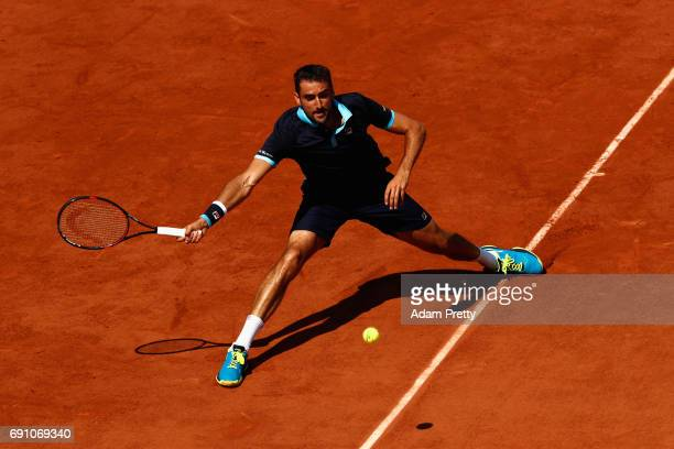 Marin Cilic of Croatia plays a forehand during the mens singles second round match against Konstantin Krachanov of Russia on day five of the 2017...