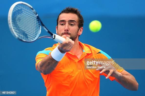 Marin Cilic of Croatia plays a forehand in his second round match against Dennis Istomin of Uzbekistan during day four of the 2014 Sydney...