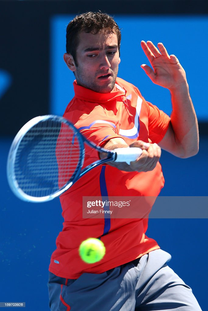 Marin Cilic of Croatia plays a forehand in his third round match against Andreas Seppi of Italy during day six of the 2013 Australian Open at Melbourne Park on January 19, 2013 in Melbourne, Australia.