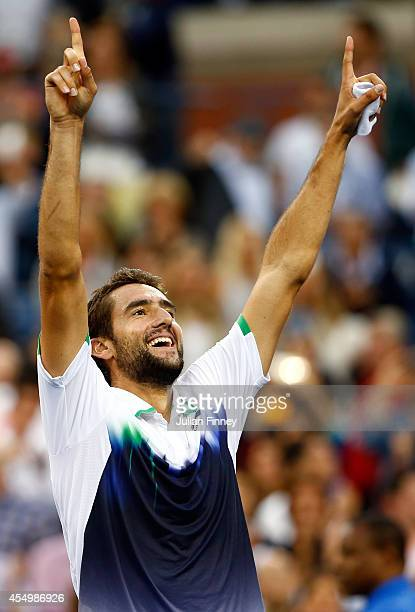 Marin Cilic of Croatia reacts after defeating Kei Nishikori of Japan to win the men's singles final match on Day fifteen of the 2014 US Open at the...
