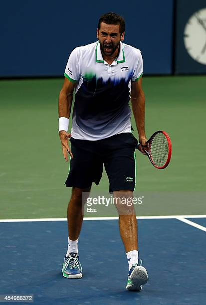 Marin Cilic of Croatia reacts after point in the third set against Kei Nishikori of Japan during the men's singles final match on Day fifteen of the...