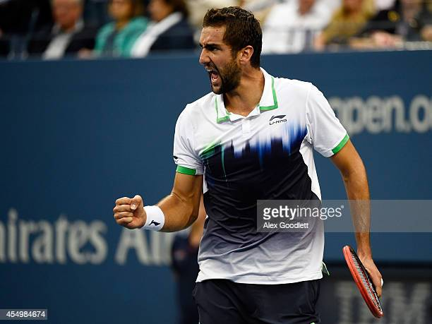 Marin Cilic of Croatia reacts against Kei Nishikori of Japan during the men's singles final match on Day fifteen of the 2014 US Open at the USTA...