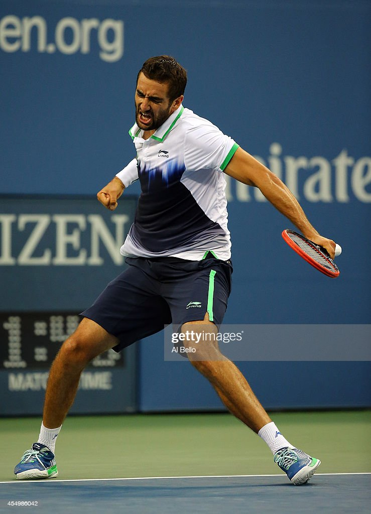 <a gi-track='captionPersonalityLinkClicked' href=/galleries/search?phrase=Marin+Cilic&family=editorial&specificpeople=553788 ng-click='$event.stopPropagation()'>Marin Cilic</a> of Croatia reacts against Kei Nishikori of Japan during the men's singles final match on Day fifteen of the 2014 US Open at the USTA Billie Jean King National Tennis Center on September 8, 2014 in the Flushing neighborhood of the Queens borough of New York City.