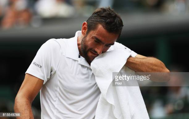 Marin Cilic of Croatia reacts during the Gentlemen's Singles final against Roger Federer of Switzerland on day thirteen of the Wimbledon Lawn Tennis...