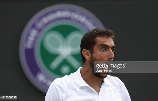 Marin Cilic of Croatia reacts during the Gentlemen's Singles quarter final match against Gilles Muller of Luxembourg on day nine of the Wimbledon...