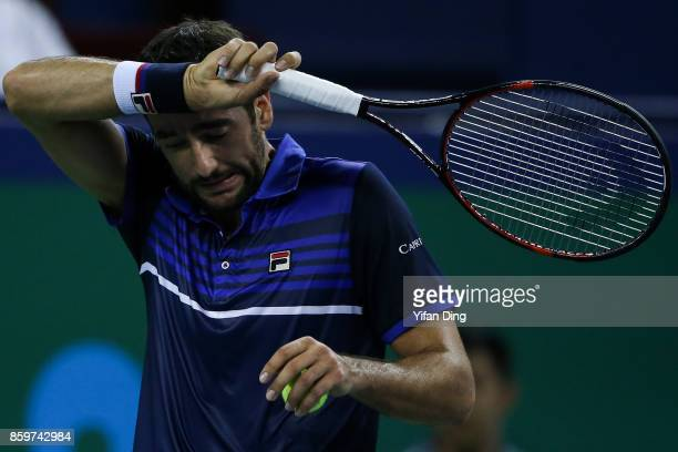Marin Cilic of Croatia reacts during the Men's singles mach against Kyle Edmund of United Kingdom on day 3 of Shanghai Rolex Masters at Qi Zhong...