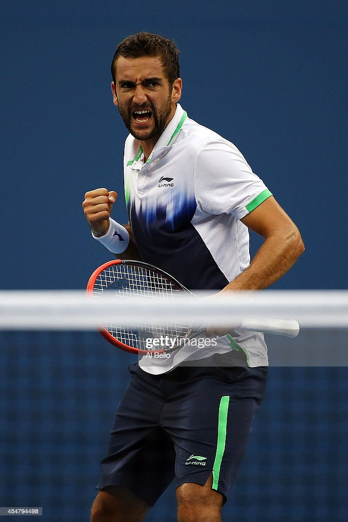 <a gi-track='captionPersonalityLinkClicked' href=/galleries/search?phrase=Marin+Cilic&family=editorial&specificpeople=553788 ng-click='$event.stopPropagation()'>Marin Cilic</a> of Croatia reacts in the third set against Roger Federer of Switzerland during their men's singles semifinal match on Day Thirteen of the 2014 US Open at the USTA Billie Jean King National Tennis Center on September 6, 2014 in the Flushing neighborhood of the Queens borough of New York City.