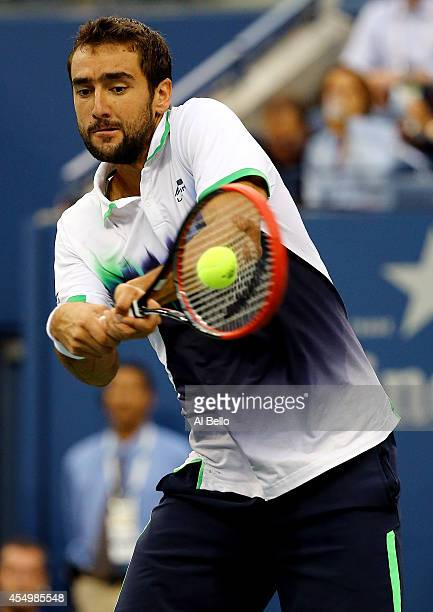 Marin Cilic of Croatia returns a shot against Kei Nishikori of Japan during the men's singles final match on Day fifteen of the 2014 US Open at the...
