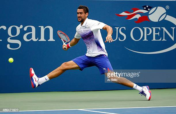 Marin Cilic of Croatia returns a shot against Mikhail Kukushkin of Kazakhstan during their Men's Singles Third Round match on Day Five of the 2015 US...