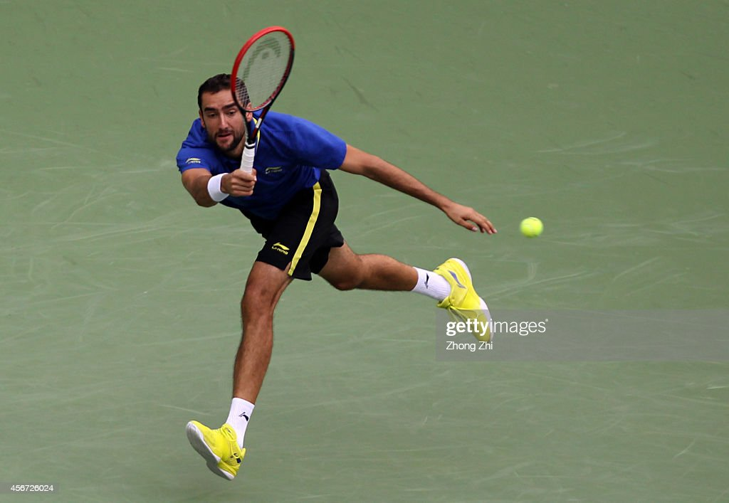 Marin Cilic of Croatia returns a shot during his match against Ivo Karlovic of Croatia during the day 2 of the Shanghai Rolex Masters at the Qi Zhong Tennis Center on October 6, 2014 in Shanghai, China.
