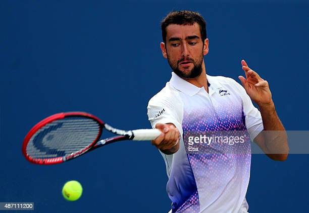 Marin Cilic of Croatia returns a shot to Jeremy Chardy of France during their Men's Singles Fourth Round match on Day Seven of the 2015 US Open at...
