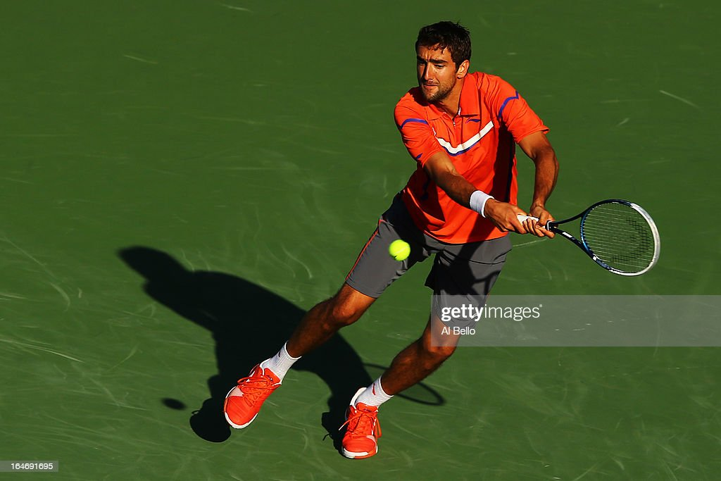 Marin Cilic of Croatia returns a shot to Jo Wilfried Tsonga of France during Day 9 of the Sony Open at the Crandon Park Tennis Center on March 26, 2013 in Key Biscayne, Florida.