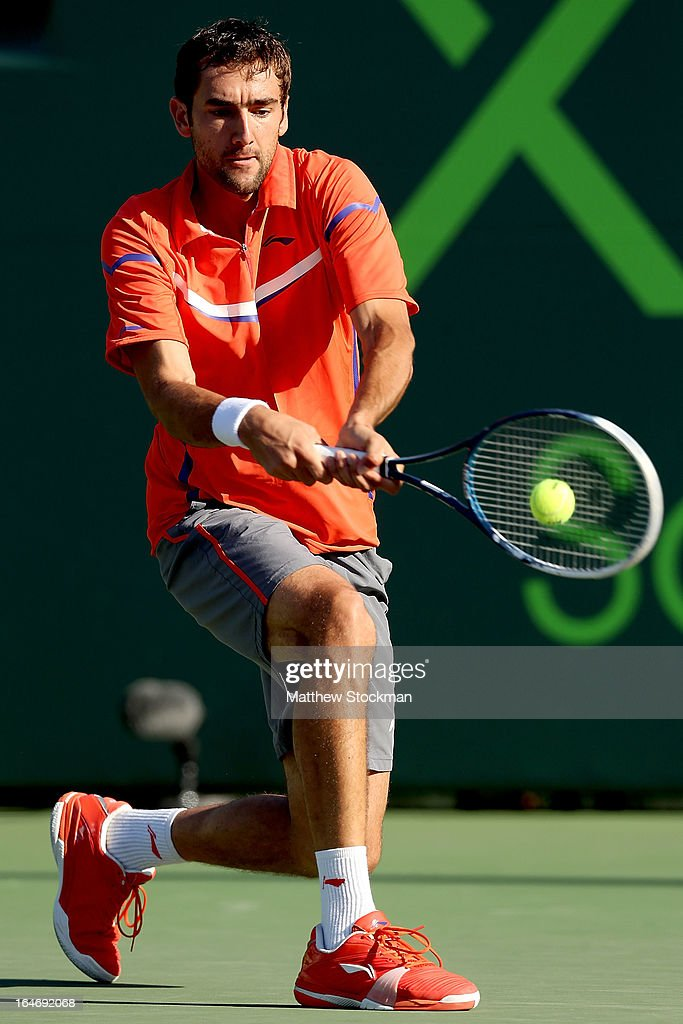 Marin Cilic of Croatia returns a shot to Jo-Wilfried Tsonga of France during the Sony Open at Crandon Park Tennis Center on March 26, 2013 in Key Biscayne, Florida.
