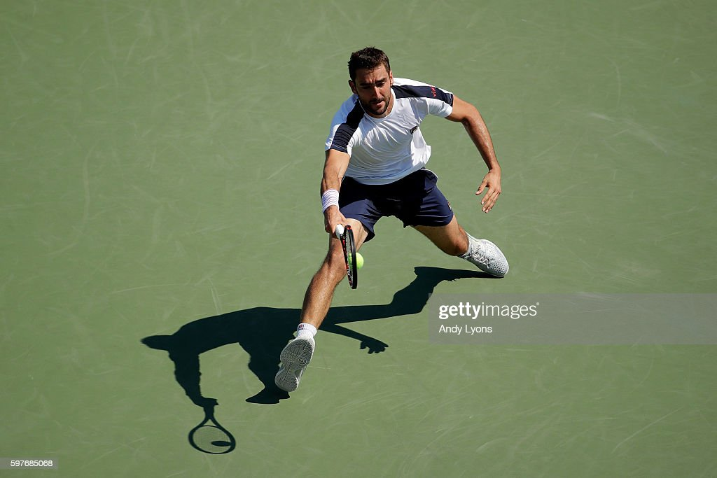 Marin Cilic of Croatia returns a shot to Rogerio Dutra Silva of Brazil during his first round Men's Singles match on Day One of the 2016 US Open at...