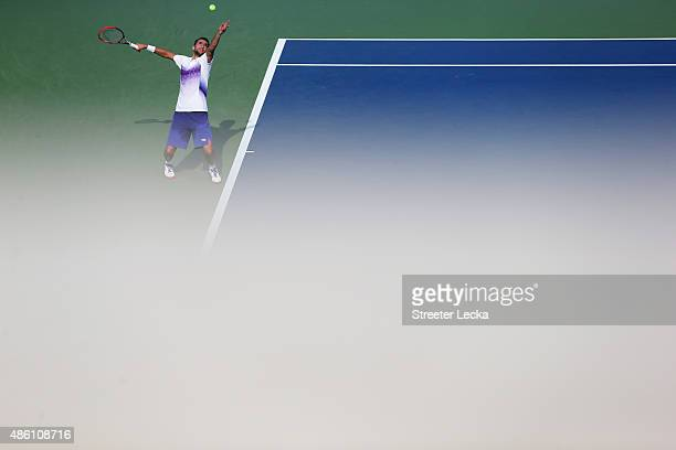 Marin Cilic of Croatia serves against Guido Pella of Argentina during their Men's Singles First Round match on Day One of the 2015 US Open at the...