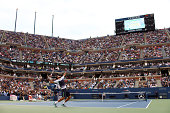 Marin Cilic of Croatia serves against Kei Nishikori of Japan during the men's singles final match on Day fifteen of the 2014 US Open at the USTA...