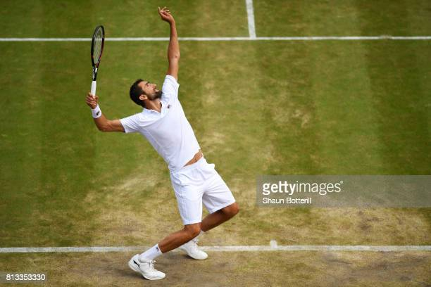 Marin Cilic of Croatia serves during the Gentlemen's Singles quarter final match against Gilles Muller of Luxembourg on day nine of the Wimbledon...