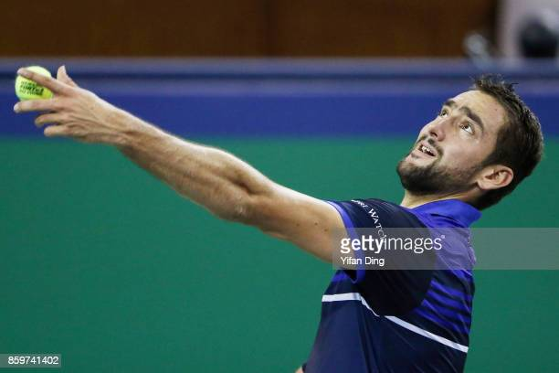 Marin Cilic of Croatia serves during the Men's singles match against Kyle Edmund of Great Britain on day three of the Shanghai Rolex Masters at Qi...