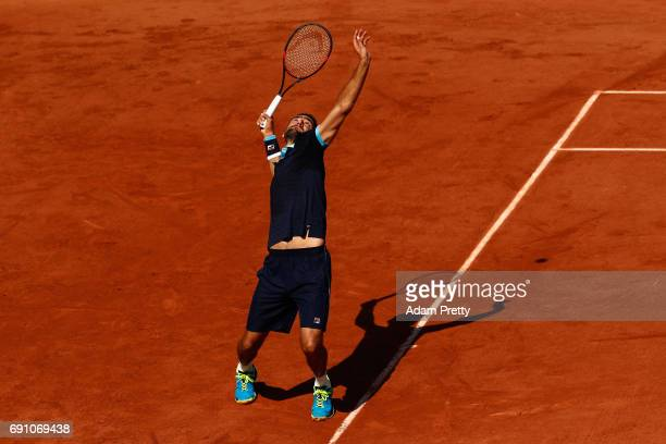 Marin Cilic of Croatia serves during the mens singles second round match against Konstantin Krachanov of Russia on day five of the 2017 French Open...