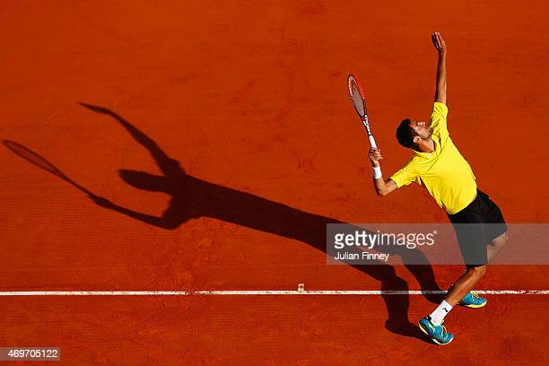 Marin Cilic of Croatia serves to Florian Mayer of Germany during day three of the Monte Carlo Rolex Masters tennis at the MonteCarlo Sporting Club on...