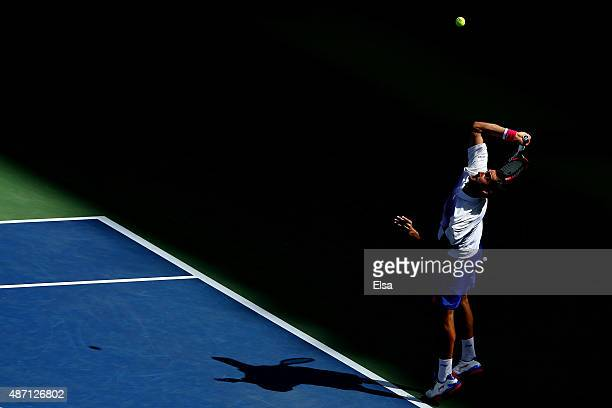 Marin Cilic of Croatia serves to Jeremy Chardy of France during their Men's Singles Fourth Round match on Day Seven of the 2015 US Open at the USTA...