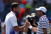 Marin Cilic of Croatia shakes hands with Jeremy Chardy of France after their Men's Singles Fourth Round match on Day Seven of the 2015 US Open at the...